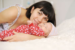 Mother Embracing Baby Royalty Free Stock Images