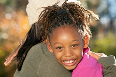 Mother Embracing Child Stock Photography