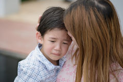 Mother embracing and consoling her son royalty free stock photo