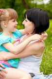 Mother embracing daughter Royalty Free Stock Images