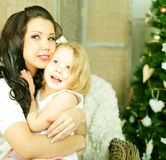 Mother embracing daughter Royalty Free Stock Photos