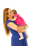 Mother embracing her baby girl Stock Images
