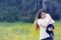 Mother embracing her child. Mother tenderly embracing her child in nature Stock Photography