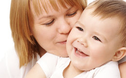 Mother embracing her happy child stock images