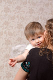 Mother embracing her little son angel Royalty Free Stock Photo