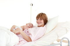 Mother embracing her newborn baby Stock Photography