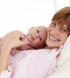Mother embracing her newborn baby Stock Images