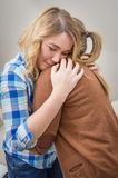 Mother embracing and soothes depressed daughter Royalty Free Stock Images