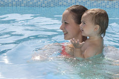 Mother enjoying a pool with child Royalty Free Stock Photography