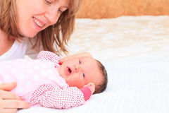 Mother enjoying time with newborn daughter Stock Photo