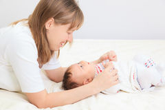 Mother enjoying time with newborn daughter Stock Photography