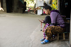 Mother Ethnic Hmong parenting child and playing mobile at house stock images