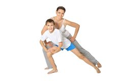 Mother exercising with son Royalty Free Stock Photos