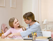 Mother explaining homework to daughter Stock Images