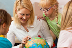 Mother explaining the world to her children Stock Photo