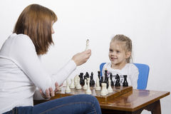 Mother explains daughter purpose of the chess pieces Royalty Free Stock Photography