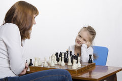 Mother explains daughter purpose of the chess pieces Royalty Free Stock Photo