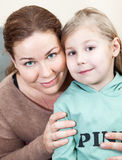 Mother face to face with preschooler daughter Stock Photos