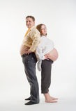 Mother and father. Husband with his pregnant wife are back to back Stock Photos