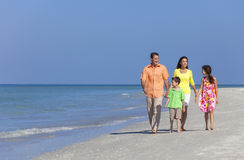 Mother Father And Children Family Walking On Beach Stock Images