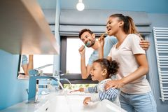 Free Mother, Father And Daughter Brushing Teeth In Bathroom Royalty Free Stock Photos - 164726108