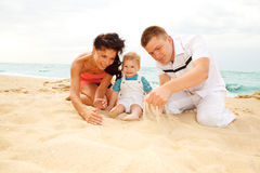 Mother, father and baby on beach Stock Photo