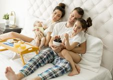 Young familly on the bed Stock Photos