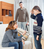 Mother and father with belt  scolding teenager Stock Photo