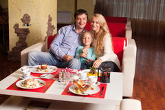 Mother, Father and child in cafe stock photos