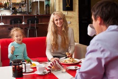 Mother, Father and child eating Stock Photos