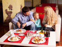 Mother, Father and child eating Royalty Free Stock Photography
