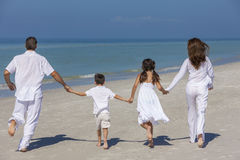 Mother Father and Children Family Running on Beach Royalty Free Stock Image