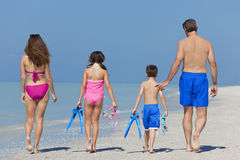 Mother, Father & Children Family Walking on Beach Royalty Free Stock Photos