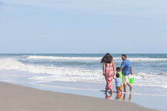 Mother Father & Children Family Walking on Beach Stock Photography
