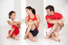 Mother,father and daughter doing yoga royalty free stock images