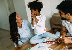 Mother and father drawing together with their child Royalty Free Stock Image