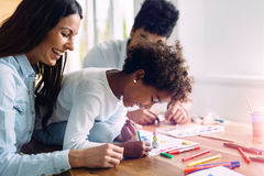 Mother and father drawing together with their child Stock Photo