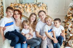 Mother, father and five children near a Christmas tree stock image