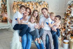 Mother, father and five children near a Christmas tree royalty free stock image