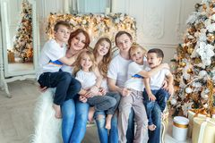 Mother father and five children near Christmas tree at home stock photo