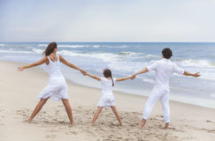 Mother Father Girl Child Family on Beach Holding Hands Stock Photography