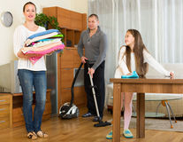 Mother, father and girl doing general cleaning Stock Photo