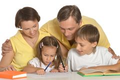 Mother and father helping their kids royalty free stock photos