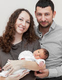 Mother and father holding newborn royalty free stock photography