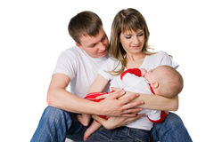 Mother and father holding their little child. Studio shot royalty free stock images