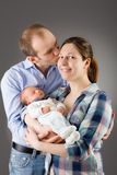 Mother and father holding their newborn baby Royalty Free Stock Photo