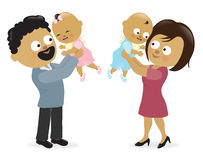 Mother and father holding up their babies Stock Images