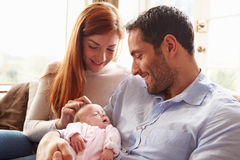 Mother And Father At Home With Newborn Baby Stock Photo