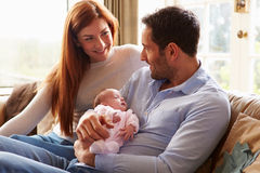 Mother And Father At Home With Newborn Baby royalty free stock photo