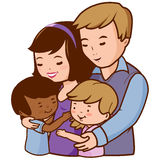 Mother and father hugging their adopted children Royalty Free Stock Image